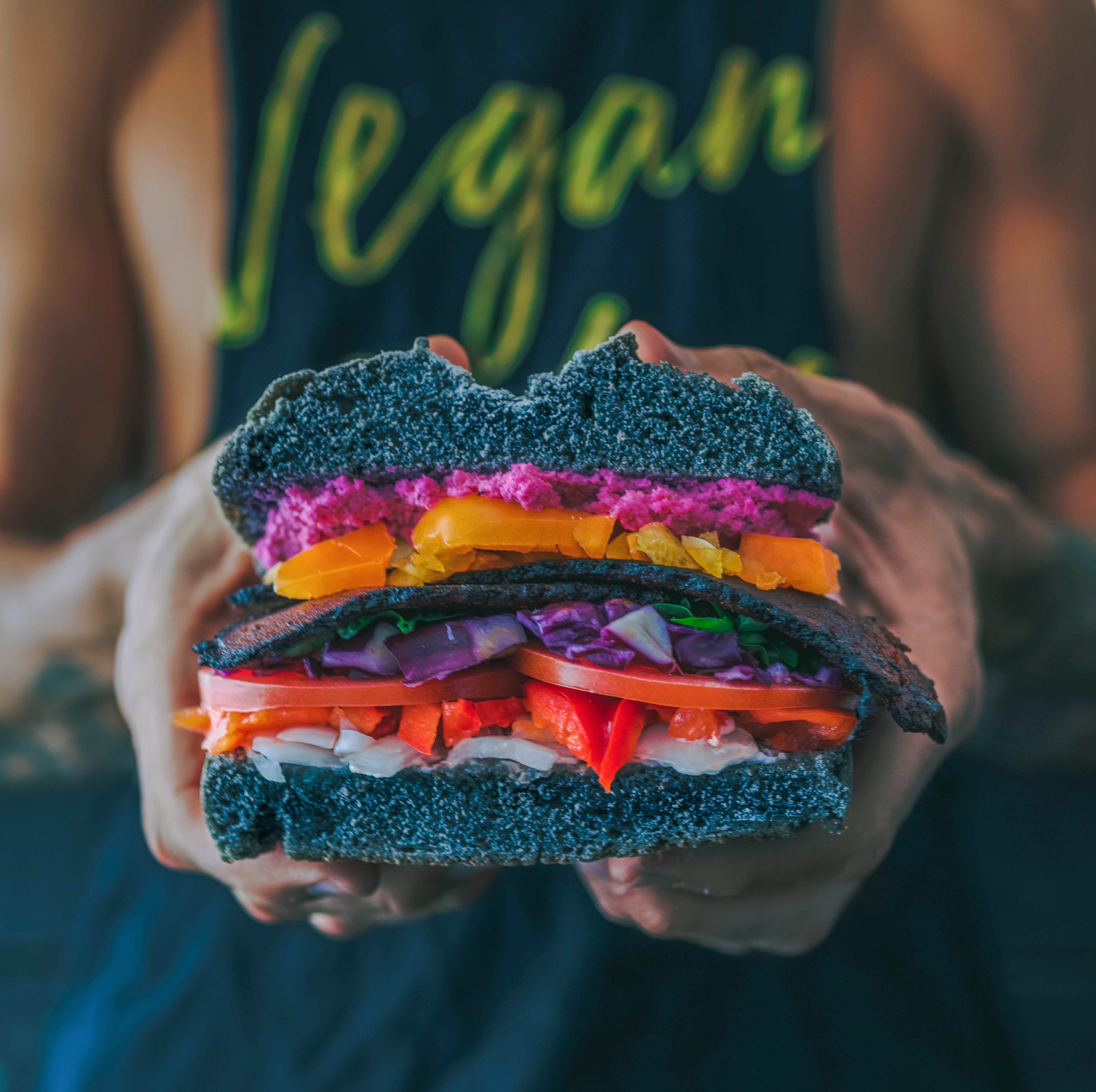 a person holding a vegan burger