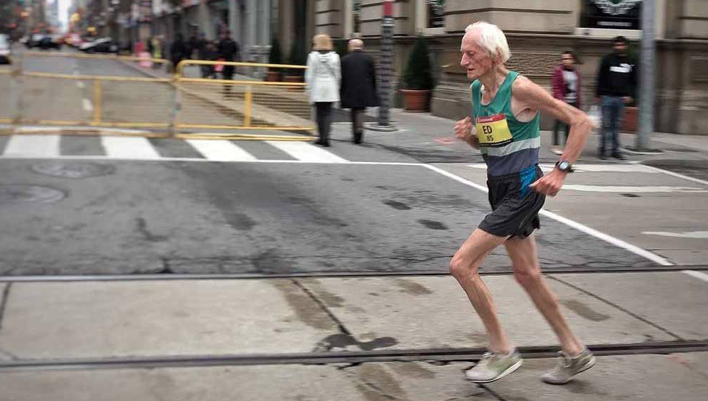 old man running in the road