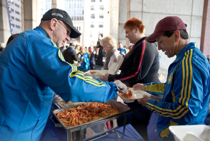 boston runners enjoying pasta